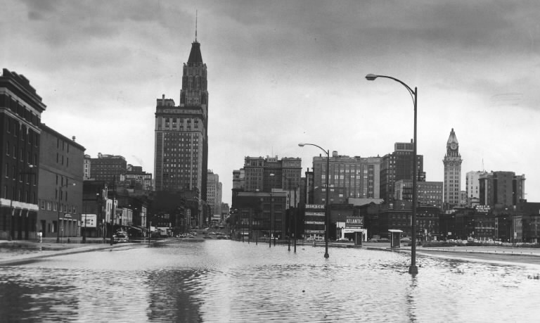 (SUN PHOTO: Light Street looking north during Connie-related flooding. Albert Cochran, Aug. 13, 1955)